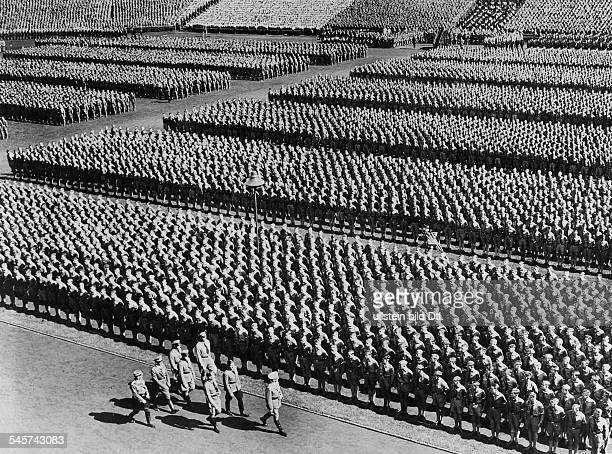 Germany Third Reich NSDAP Nuremberg Rally 1936 Adolf Hitler taking the salute of the HItler Youth at the rally ground