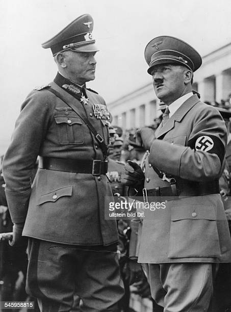Germany Third Reich NSDAP Nuremberg Rally 1936 Adolf Hitler talking to Reich Minister of Defense Werner von Blomberg