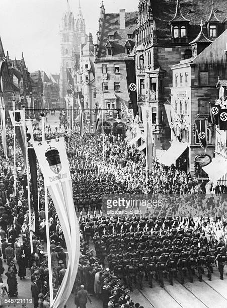 Germany Third Reich NSDAP Nuremberg Rally 1936 Columns of the Reich Labour Service marching through the streets of Nuremberg