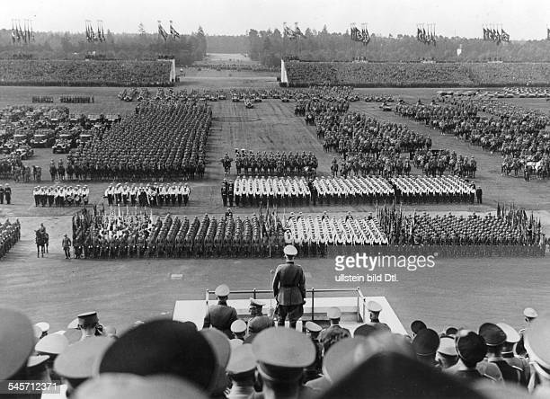 Germany Third Reich NSDAP Nuremberg Rally 1936 Parade of the Wehrmacht at the rally ground standing on the rostrum Reich Minister of Defense Werner...