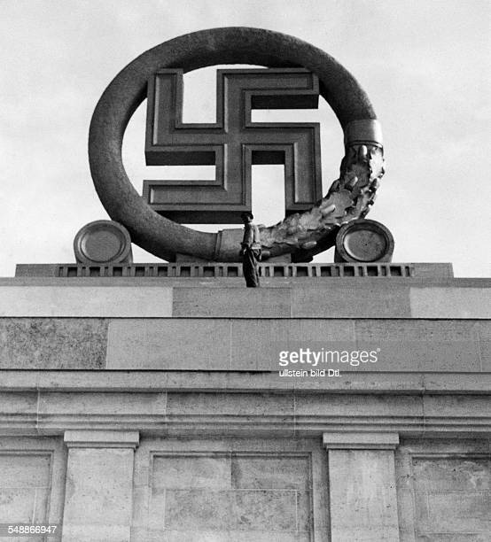 Germany Third Reich NSDAP Nuremberg Rally 1937 A huge swastika being mounted on the grand stand of the rally ground 1937 undated Photographer...