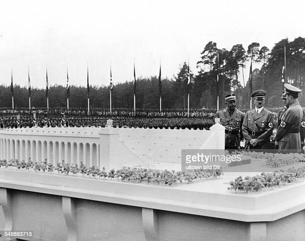 Germany Third Reich NSDAP Nuremberg Rally 1937 Adolf Hitler inspecting a model of the planned 'German stadium' before the laying of its foundation...