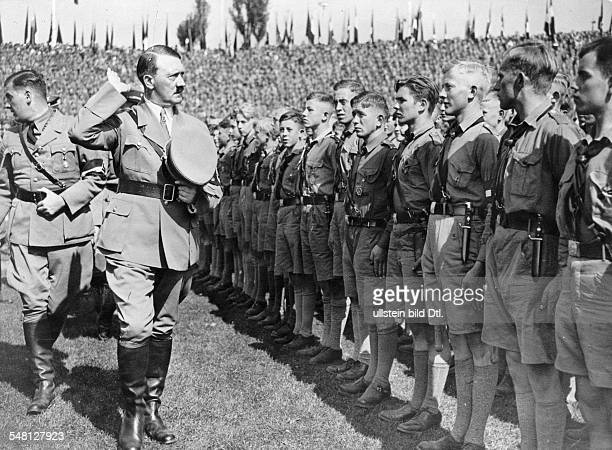 Germany Third Reich Nuremberg Rally 1934 Adolf Hitler and Nazi Youth leader Baldur von Schirach on their arrival in the stadium for the Hitler Youth...