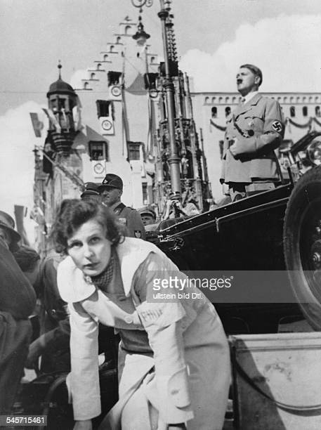 Germany, Third Reich - Nuremberg Rally 1934 Adolf Hitler at the rostrum of the Party rally| in front: Leni Riefenstahl at a shooting for the film...