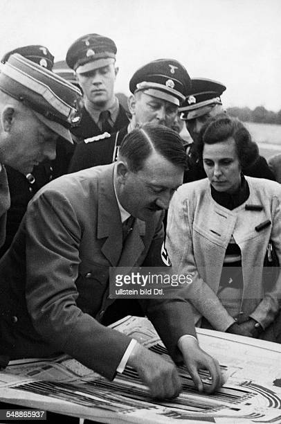Germany Third Reich Nuremberg Rally 1934 Adolf Hitler checking plans for the forthcoming parades on the terrain of the Nuremberg rally| at the right...