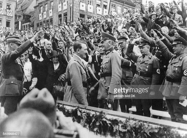 Germany Third Reich Nuremberg Rally 1934 Adolf Hitler welcoming Reich Minister of Defense General Werner von Blomberg during a rally at the Adolf...