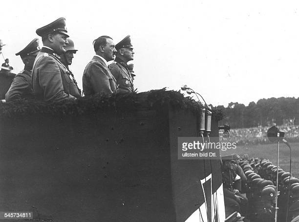 Germany Third Reich Nuremberg Rally 1934 VIP rostrum during the marchpast of the units on 'Defense Force Day'| from the left Hermann Goering Adolf...