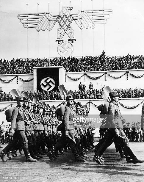 Germany Third Reich Nuremberg Rally 1935 A column of the Reich Labour Service marching past Hitler and other Nazi leaders on the rally ground...