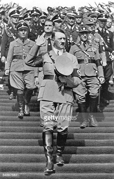 Germany Third Reich Nuremberg Rally 1935 Adolf Hitler and behind him the head of the Reich Labour Front Robert Ley Rudof Hess and the head of the...