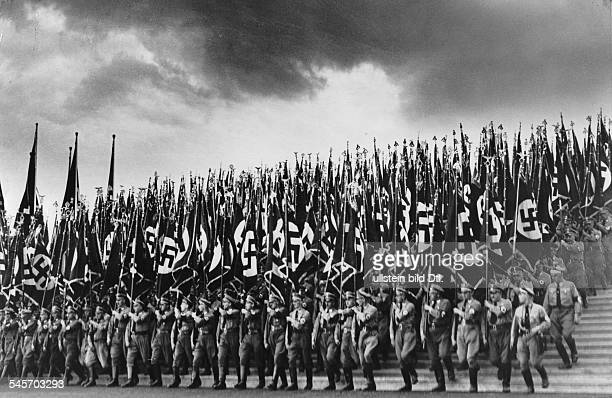 Germany Third Reich Nuremberg Rally 1935 Flag detachments of the party organisation during a roll call of the political leaders at the rally ground|