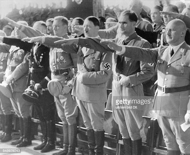 Germany Third Reich Nuremberg Rally 1935 Nazi leaders paying tribute to the Nazi ceremonial flag the socalled 'blood flag' during the opening session...