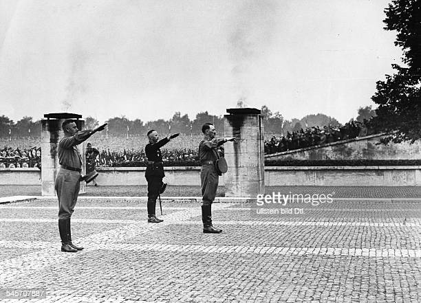 Germany Third Reich Nuremberg Rally 1937 Commemoration ceremony for 'those who fell for the movementin the center Adolf Hitler