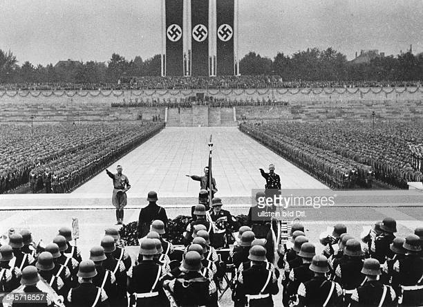 Germany Third Reich Nuremberg Rally 1937 Parade of the 'NS Combat Units' at the rally ground SA chief of staff Victor Lutze Adolf Hitler and the head...