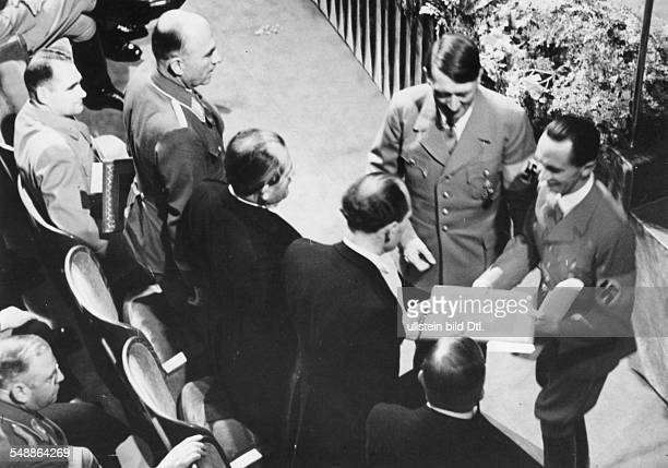 Germany, Third Reich - Nuremberg Rally 1938 Adolf Hitler and Joseph Goebbels presenting the 'German National Award for Art and Science' at the...