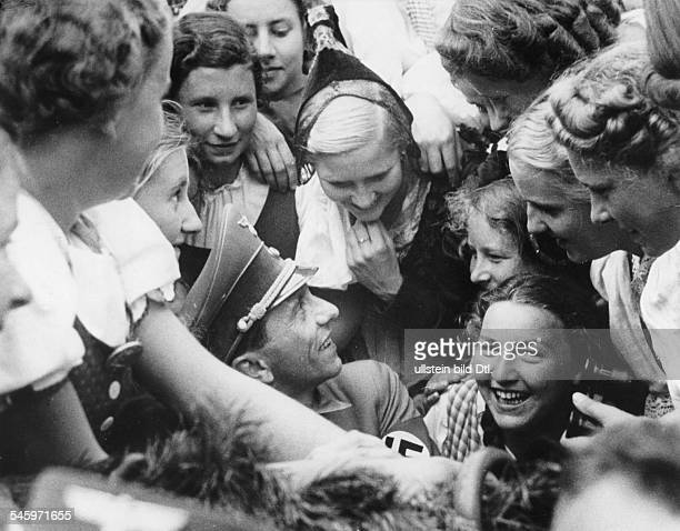 Germany Third Reich Nuremberg Rally 1938 Joseph Goebbels the Nazi propaganda chief is surrounded by excited girls from Nazioccupied Austria during a...