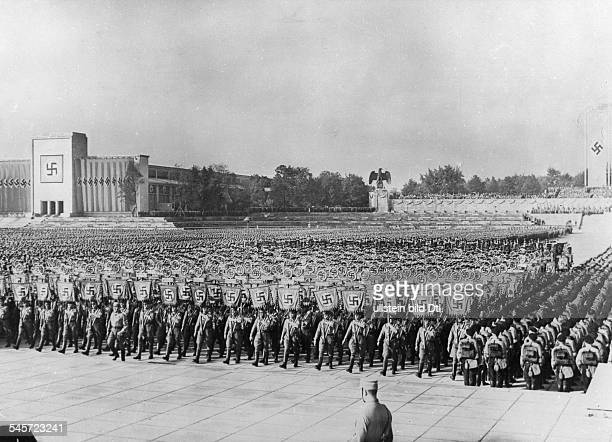Germany Third Reich Nuremberg Rally 1938 Parade of the standards at the rally ground at the background left the Luitpold Hall