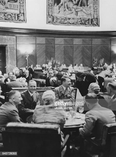 Germany Third Reich Reception at the 'Fuehrer Building' at the Koenigsplatz in Munich Adolf Hitler talking to his guests left next to Hitler Hitler...