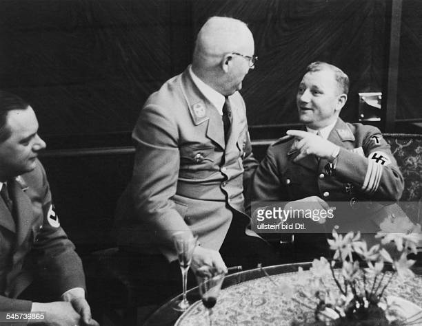 Germany Third Reich Reception at the 'Fuehrerbau' on the Koenigsplatz in Munich SA Chief of Staff Victor Lutze talking to Reich treasurer Franz Xaver...