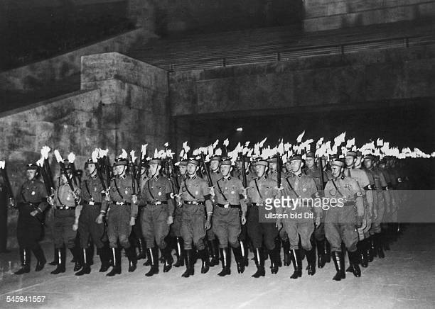 Germany Third Reich SA men with torches marching into the Olympic Stadium, Berlin, for the solstice festival -