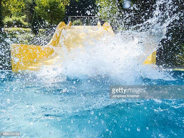 Germany, Thuringia, Boy (6-7) making splash in pool