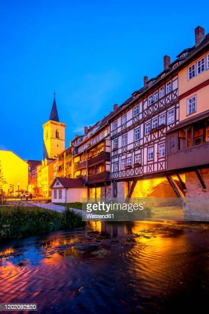 germany, thuringia, erfurt, kramerbrucke illuminated at night - erfurt stock pictures, royalty-free photos & images