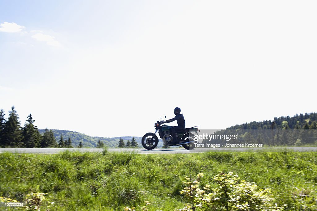 Germany, Thuringia, Suhl, Motorbike on country road : Stock-Foto