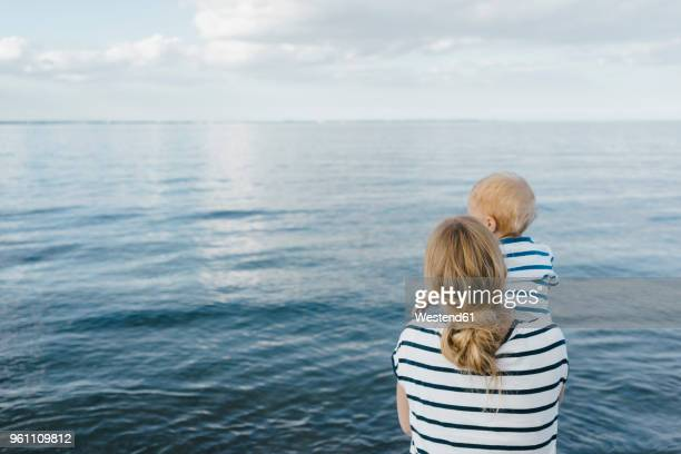 Germany, Timmendorfer Strand, mother holding his son