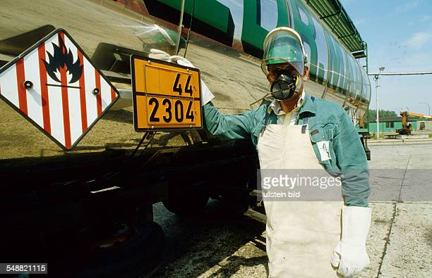 Hazardous material driver with protective clothing to unload naphtalin