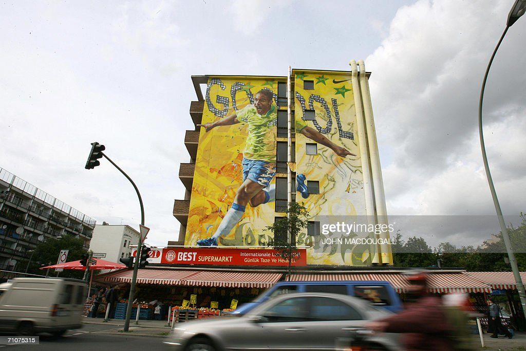 Traffic makes its way past a giant mural : News Photo