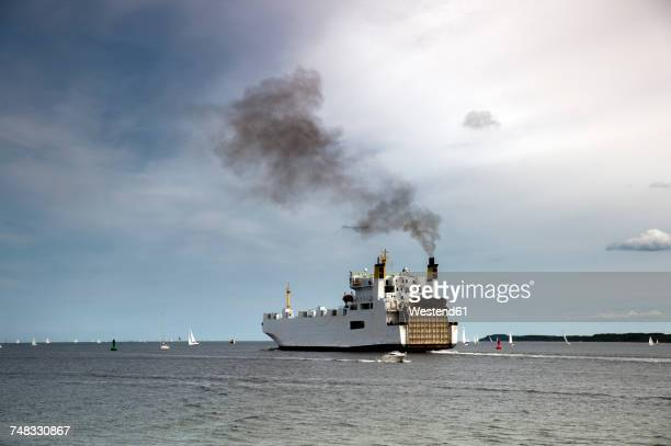 Germany, Travemuende, ferry on the sea emitting smoke