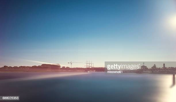 Germany, Travemuende, port entrance with driving ferry, long exposure