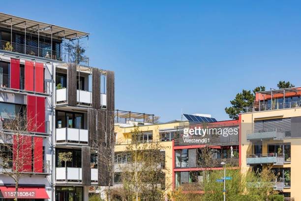germany, tuebingen, muehlenviertel, modern residential zero-energy houses - sustainable architecture stock pictures, royalty-free photos & images