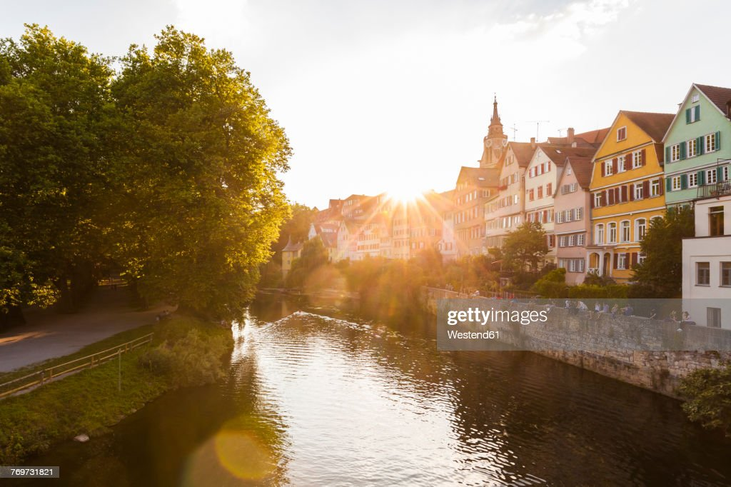 Germany, Tuebingen, view to the city with Neckar River in the foreground at evening twilight : Stock Photo