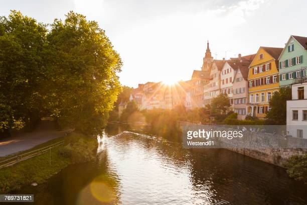 Germany, Tuebingen, view to the city with Neckar River in the foreground at evening twilight