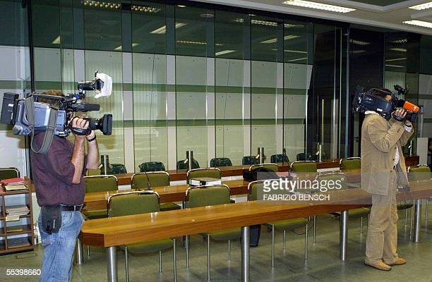 TV crews film the empty courtroom for the case against three Turkish brothers Ayhan Alpaslan and Mutlu Surucu in Berlin on 14 September 2005 The...
