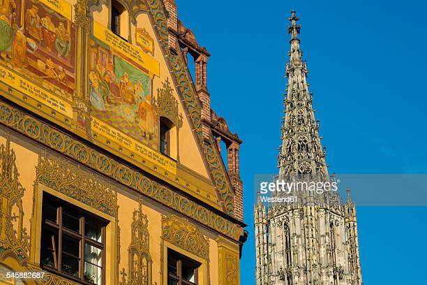 germany, ulm, mural paintings at 16th century townhall, ulm minster in background - minster stock photos and pictures