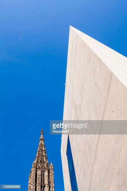 germany, ulm, ulmer minster church and facade of modern office building - minster stock photos and pictures