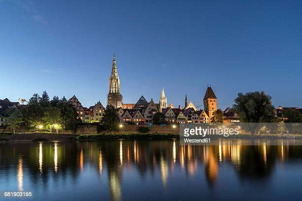 Germany, Ulm, view to the city with Danube River in the foreground at dusk