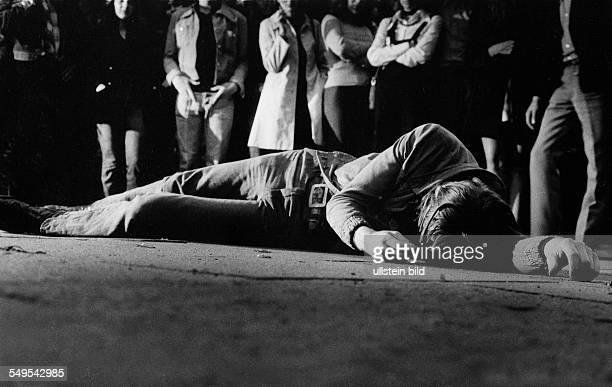 Germany unconscious young man lying on the street onlookers dont help
