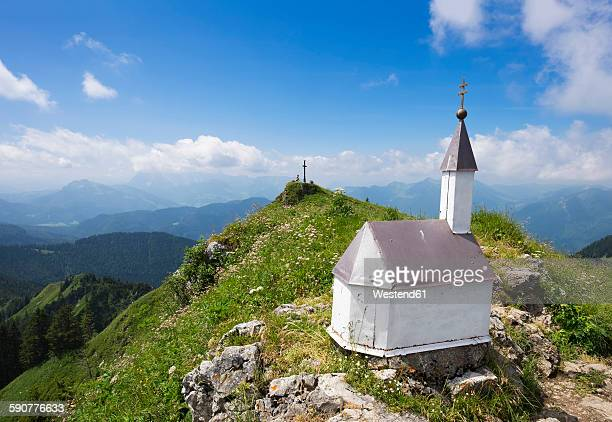 Germany, Unterwoessen, summit cross on Hochgern and miniature chapel in the foreground