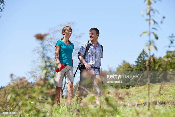 germany, upper bavaria, couple hiking, smiling - upper bavaria stock photos and pictures