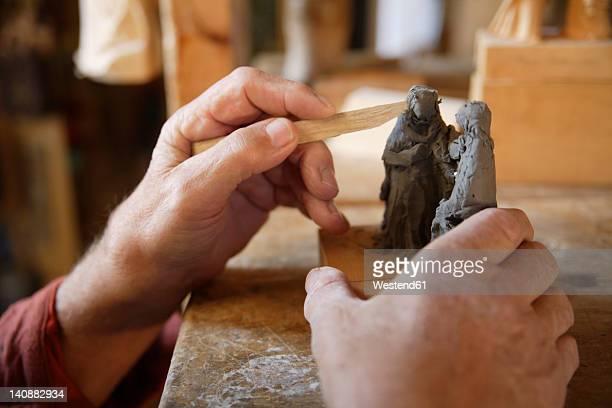 Germany, Upper Bavaria, Craftsperson carving statue, close up