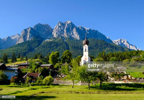 germany, upper bavaria, grainau with etterstein mountains in background - upper bavaria stock photos and pictures