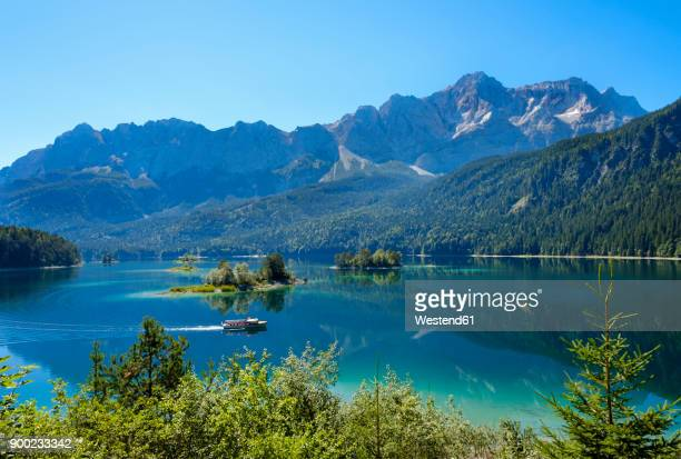 Germany, Upper Bavaria, Lake Eibsee with Waxenstein, Rifelwandspitze and Zugspitze mountains in background