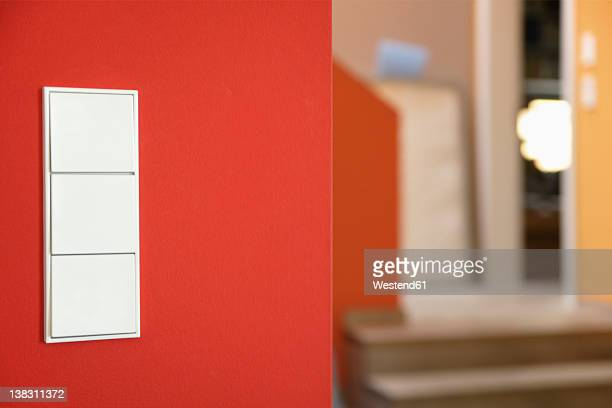 Germany, Upper Bavaria, Munich, Light switch on wall of new house