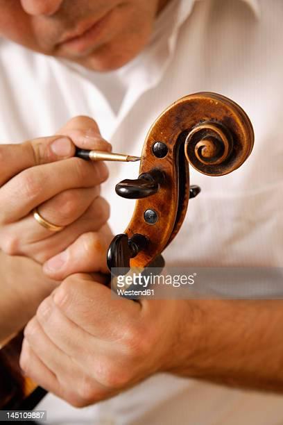 Germany, Upper Bavaria, Schaeftlarn, Violin maker making violin, close up