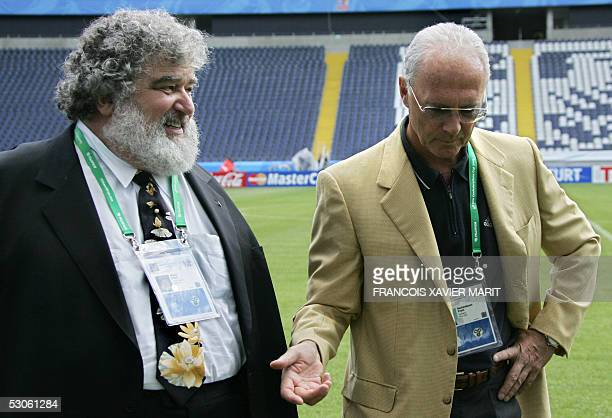 US Chuck Blazer chairman of the FIFA organizing Committee for the Confederations Cup walks with German football legend Franz Beckenbauer president of...