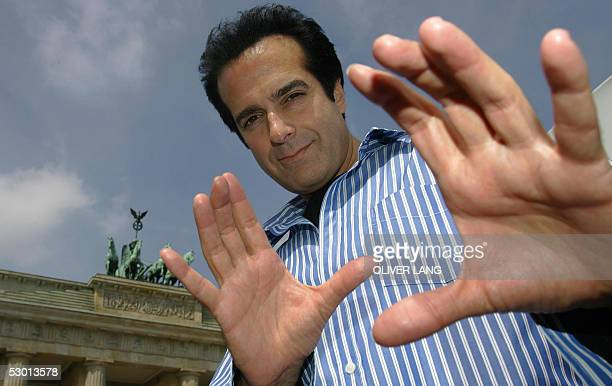 US magician David Copperfield poses in front of Berlin's landmark Brandenburg Gate 03 June 2005 He came to the German capital to promote his new show...