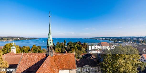 germany, view to lake constance with spire of constance minster in the foreground - architektonisches detail stock-fotos und bilder
