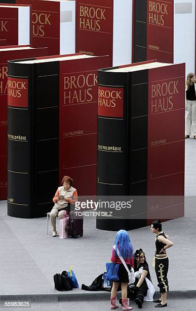 Visitors are seen among giant replicas of German encyclopaedia Brockhaus 22 October 2005 at Frankfurt's international book fair on the first day open...